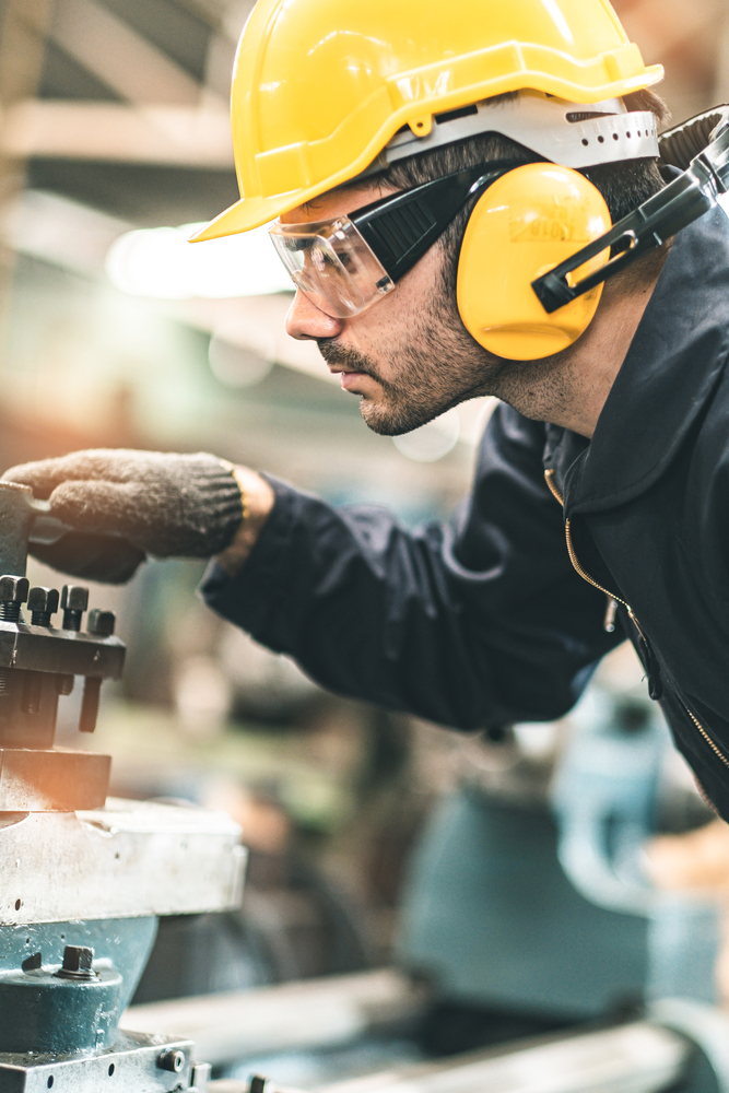Industrial,Engineers,In,Hard,Hats.work,At,The,Heavy,Industry,Manufacturing